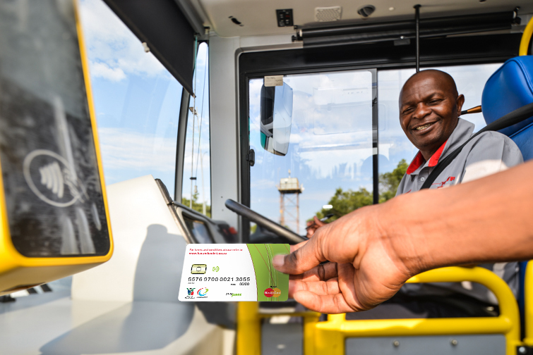 passenger using his EKU Card to tap into the bus
